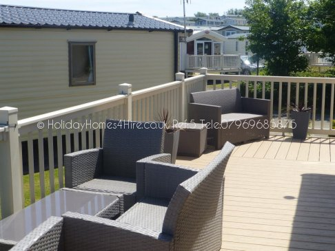 Reighton Sands 2 bedroom 6 berth Lodge caravan hire side decking front view