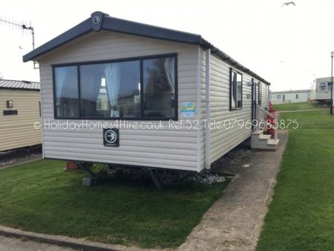 Primrose Valley 3 bedroom 8 Berth Caravan full exterior and steps view Ref52