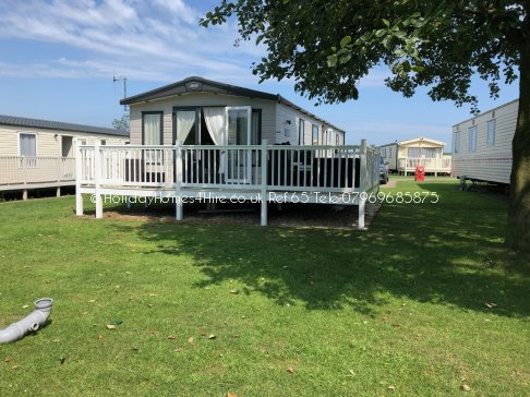 Primrose Valley 3 bedroom 6 Berth Caravan full exterior and wrap decking Ref65