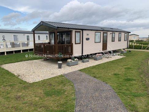 Primrose Valley 3 bedroom 8 Berth Caravan full side exterior decking & canopy Ref20