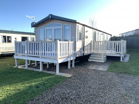 Primrose valley 2 Bedroom 6 Berth caravan hire full exterior view with two decking's.