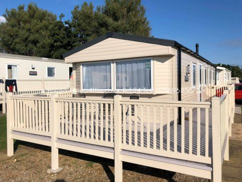 Primrose Valley 3 bedroom 6 Berth Caravan hire full exterior front with decking view Ref24