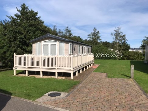 Primrose Valley 2 bedroom 6 Berth Caravan full exterior with decking view Ref40