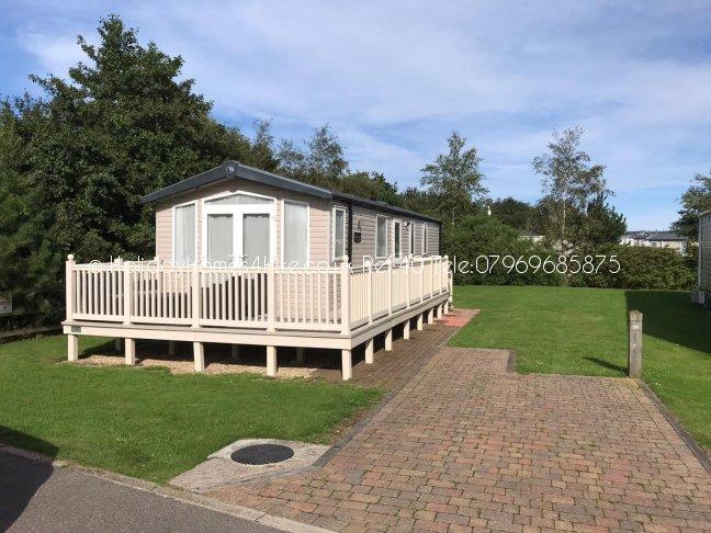 Primrose Valley 2 bedroom 6 Berth Caravan full exterior with decking view Ref40