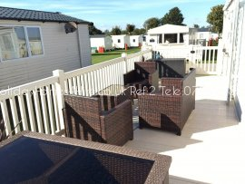 Primrose Valley 3 bedroom 6 Berth Caravan hire side decking with rattan seating