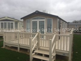 Primrose Valley 2 bedroom 6 Berth Caravan full frontal exterior an decking view Ref21