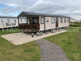 Primrose Valley 3 bedroom 8 Berth Caravan full side exterior decking & canopy Ref20
