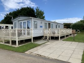Primrose Valley 3 bedroom 6 Berth Caravan hire full exterior side shot with decking's.